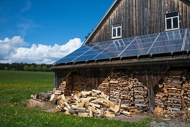 solar collector with fire wood at barn - solar panel bildbanksfoton och bilder