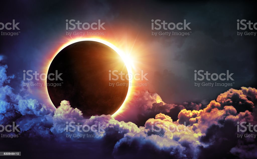 Solar Eclipse In Clouds stock photo