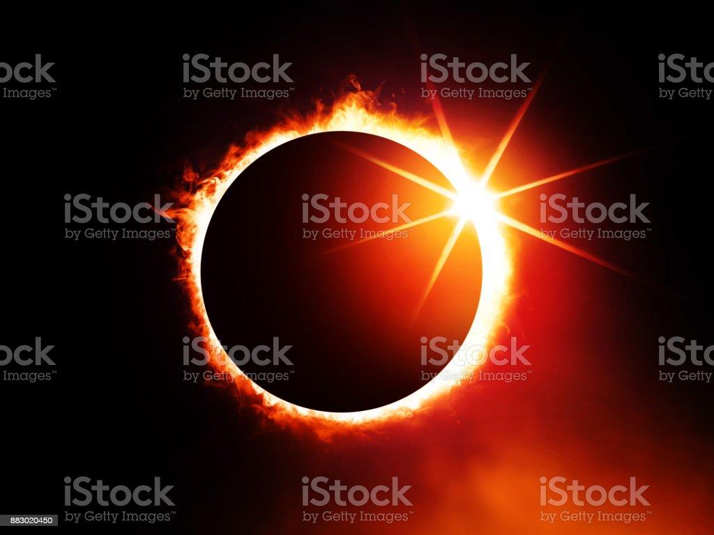 solar eclipse on dark sky stock photo