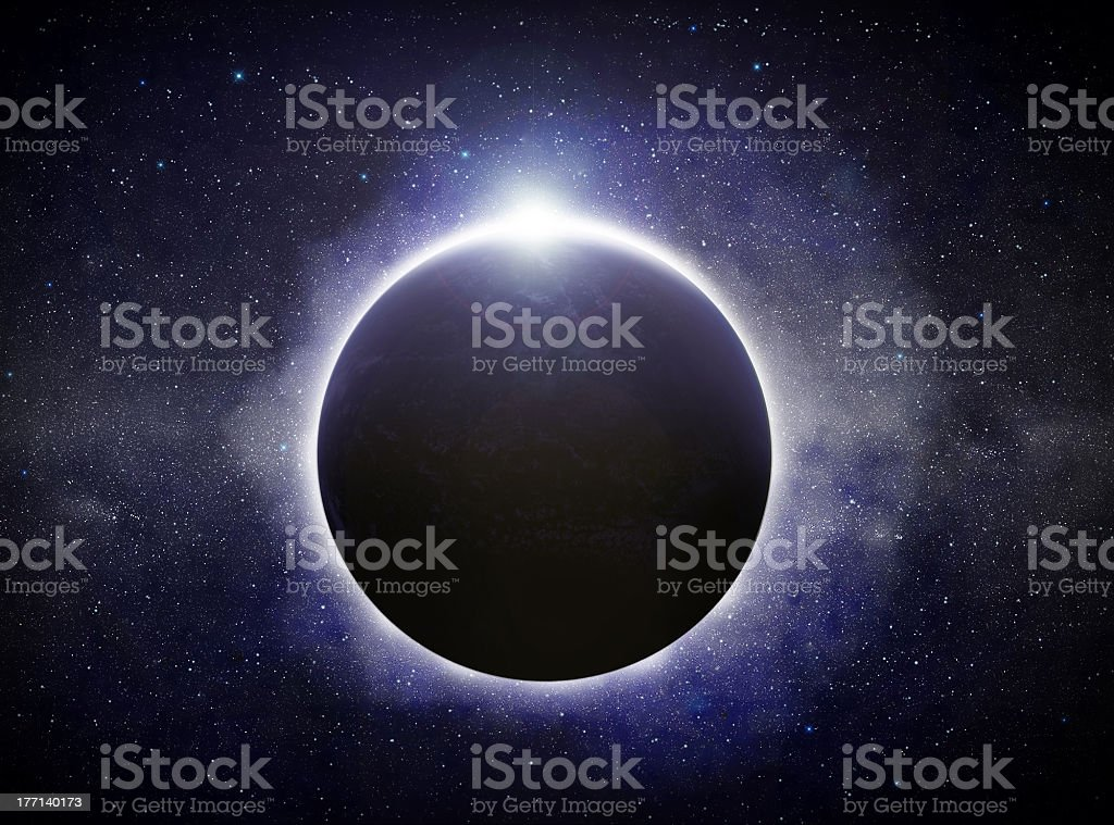 A solar eclipse on planet earth stock photo