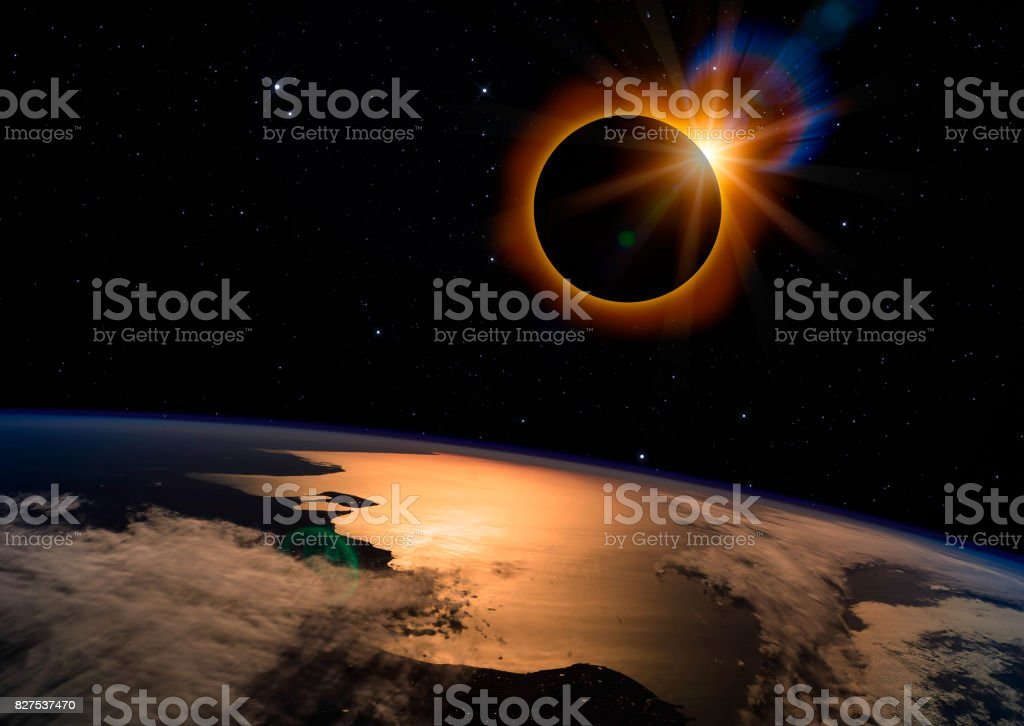 Solar Eclipse on Starry Sky Solar eclipse with orange halo over the planet Earth, on dark starry sky Astronomy Stock Photo