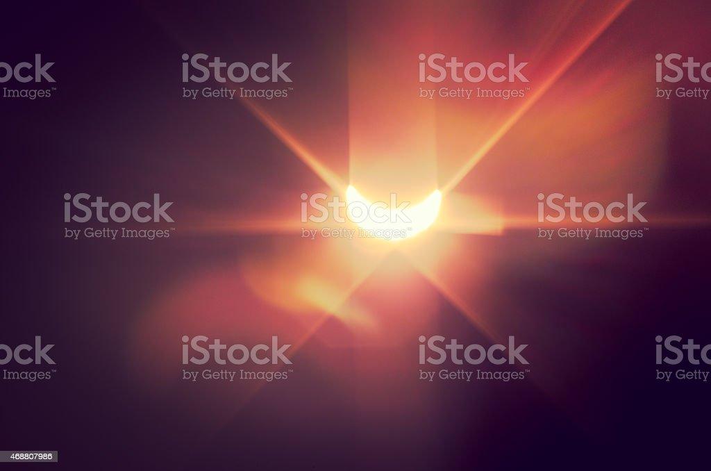 Solar eclipse with naïve light effect stock photo