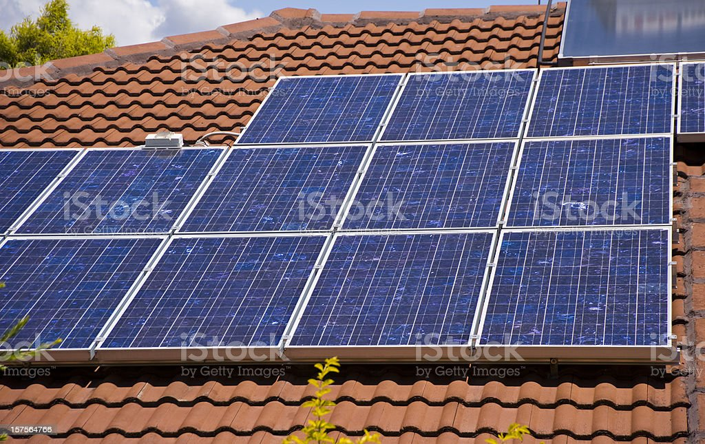Solar Electricity Panels on house roof stock photo