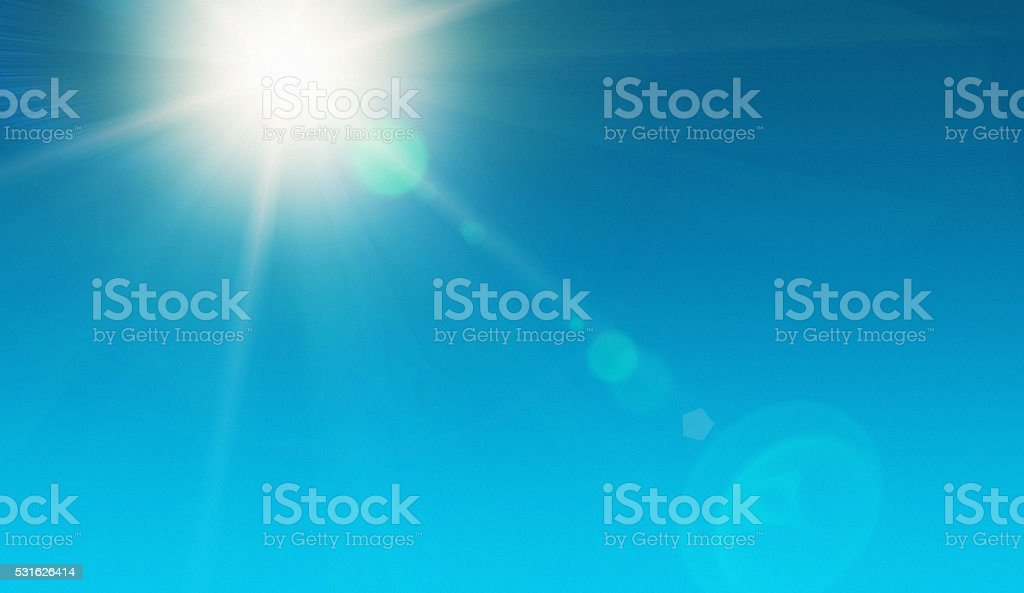Solar energy! Blazing noonday sun in clear sky Looking up at the dazzling sun, high in the noonday sky and showing natural zoom lens flare. The source of our solar power. Ample copy space on sky. 12 O'Clock Stock Photo