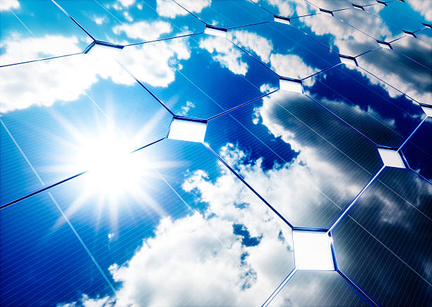 solar energy concept. blue sky reflection on photovoltaic panel. - solarstrom stock-fotos und bilder