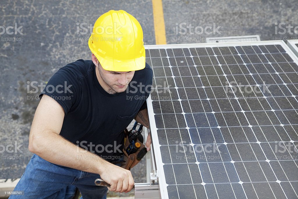 Solar Energy - Electrician Working royalty-free stock photo