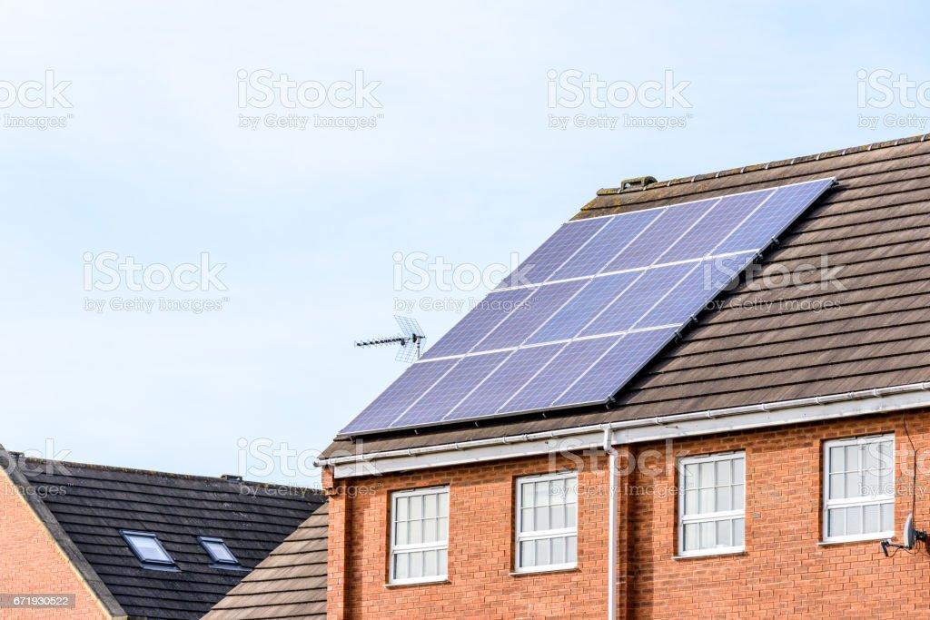 UK Solar Energy Panel on Sunny Roof stock photo