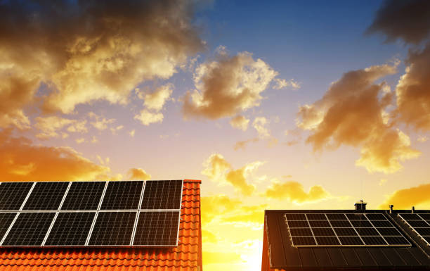 Solar energy panel on the roof of the house. stock photo