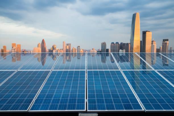 solar energy panel with city twilight stock photo