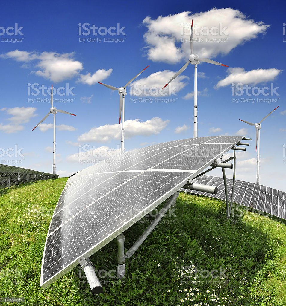 solar energy panels and wind turbine royalty-free stock photo