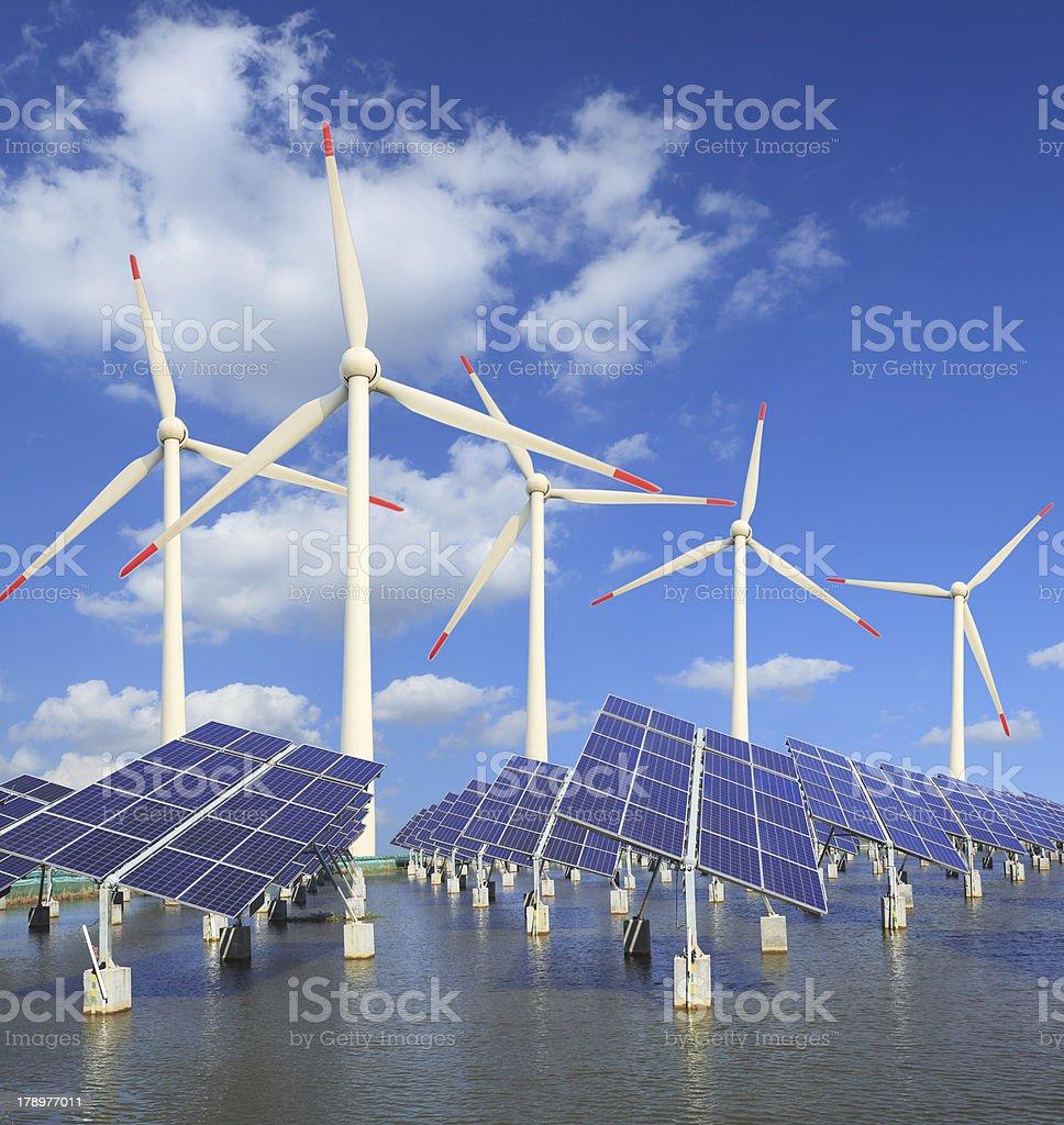 solar energy panels and wind turbine royalty-free stock photo