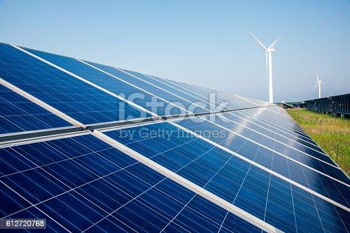 istock solar energy panels and wind turbine 612720768