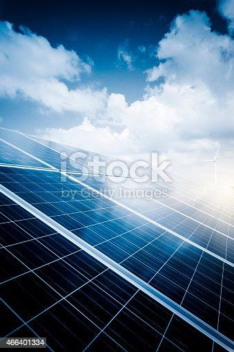 istock solar energy panels and wind turbines 466401334