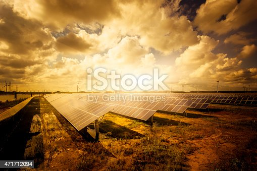 istock solar energy panels and wind turbines 471712094