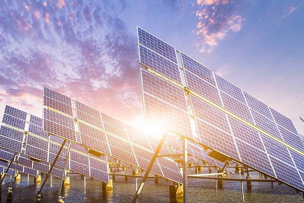solar energy panels and wind turbines - power in nature stock photos and pictures