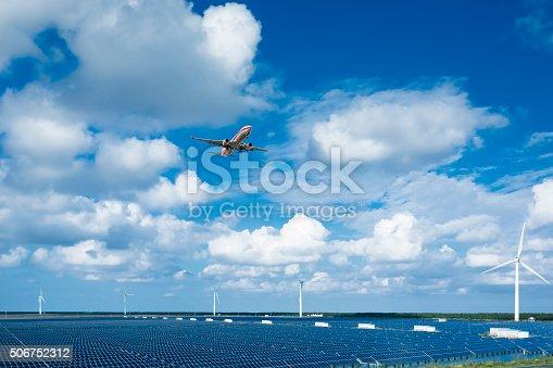 istock solar energy panels and wind turbines 506752312