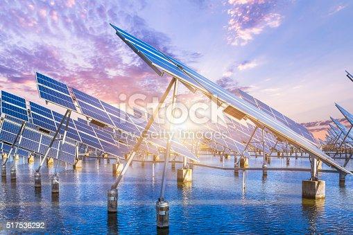 istock solar energy panels and wind turbines 517536292