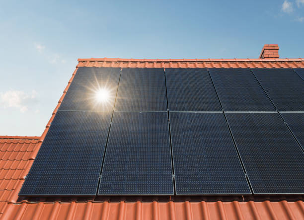 Solar energy panels at the rooftop stock photo