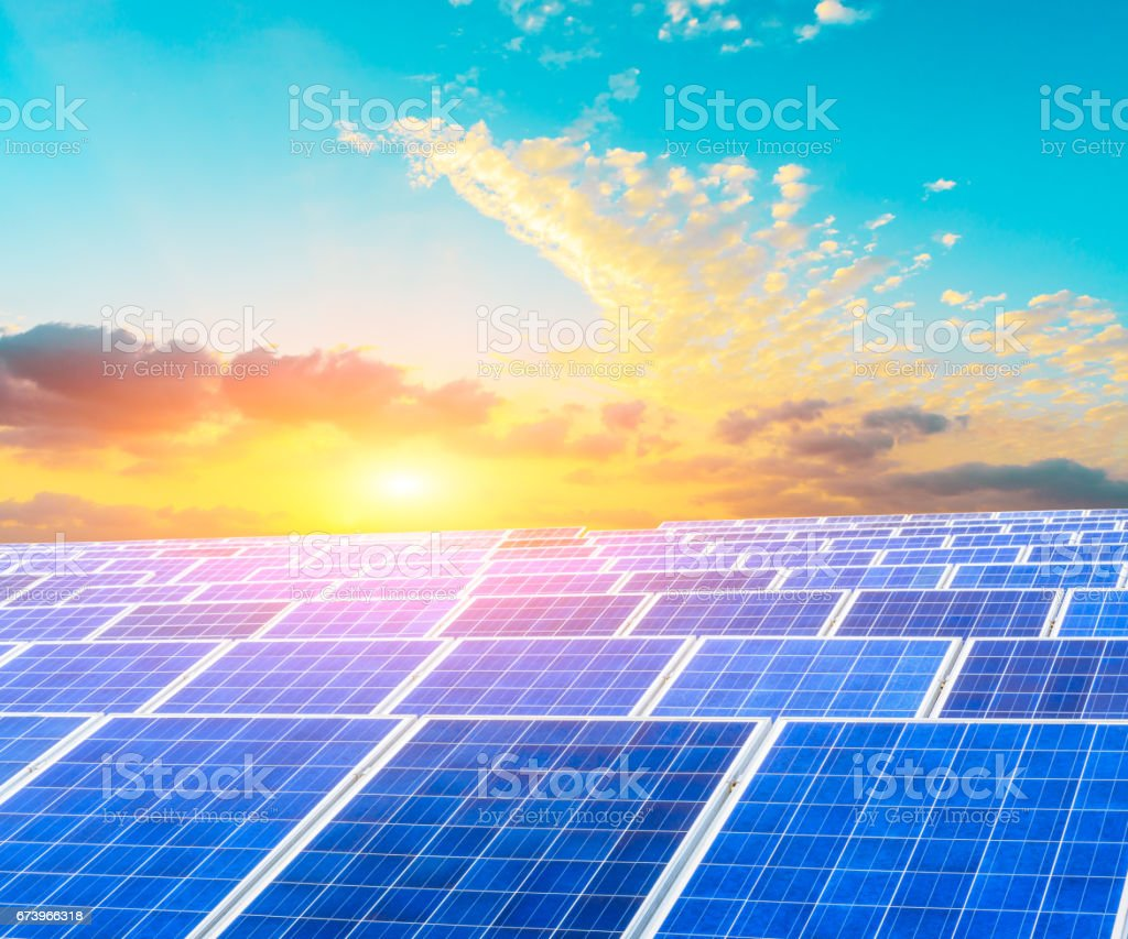 Solar energy panels scene in the sunset royalty-free stock photo