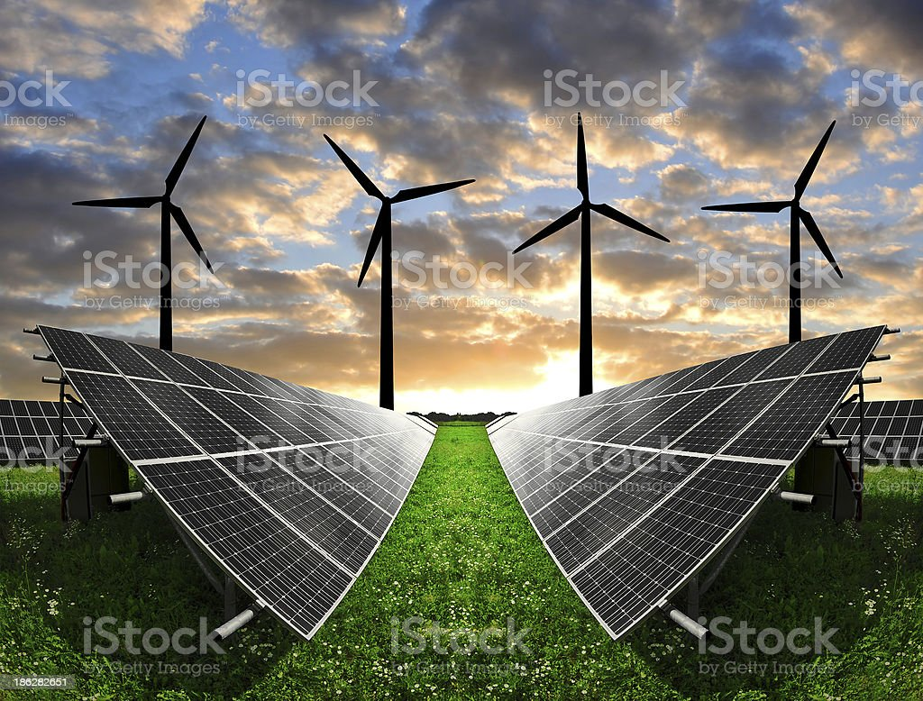 Solar energy panels with wind turbines stock photo