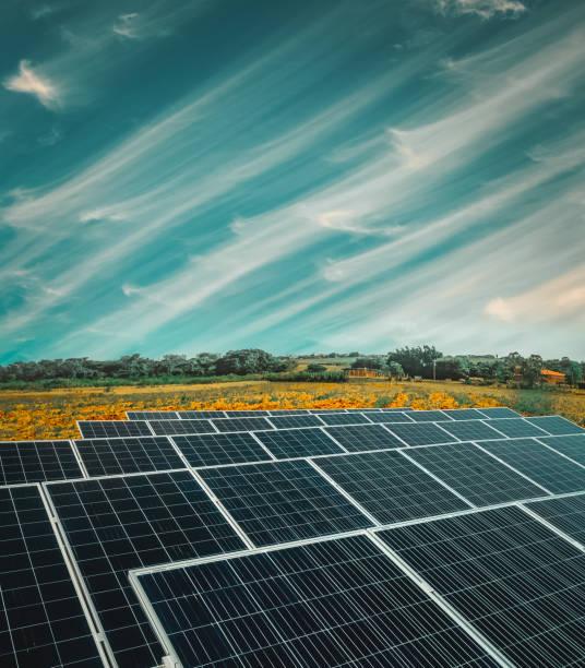 solar energy power plant over a beautiful cloudy sky - solar panel imagens e fotografias de stock