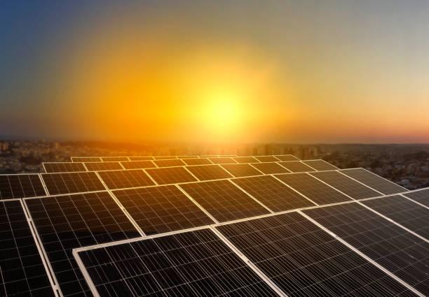 solar energy power plant over a beautiful sundown sky - solar panel imagens e fotografias de stock