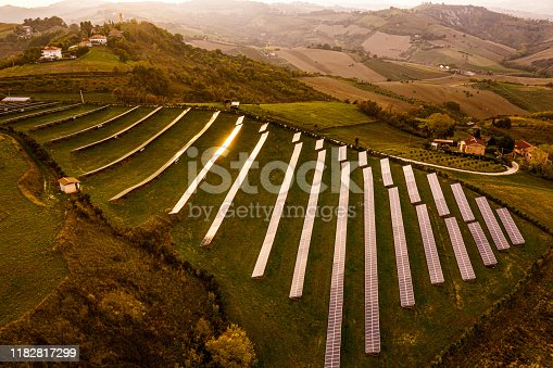 1170098138istockphoto Solar energy station in countryside aerial view 1182817299