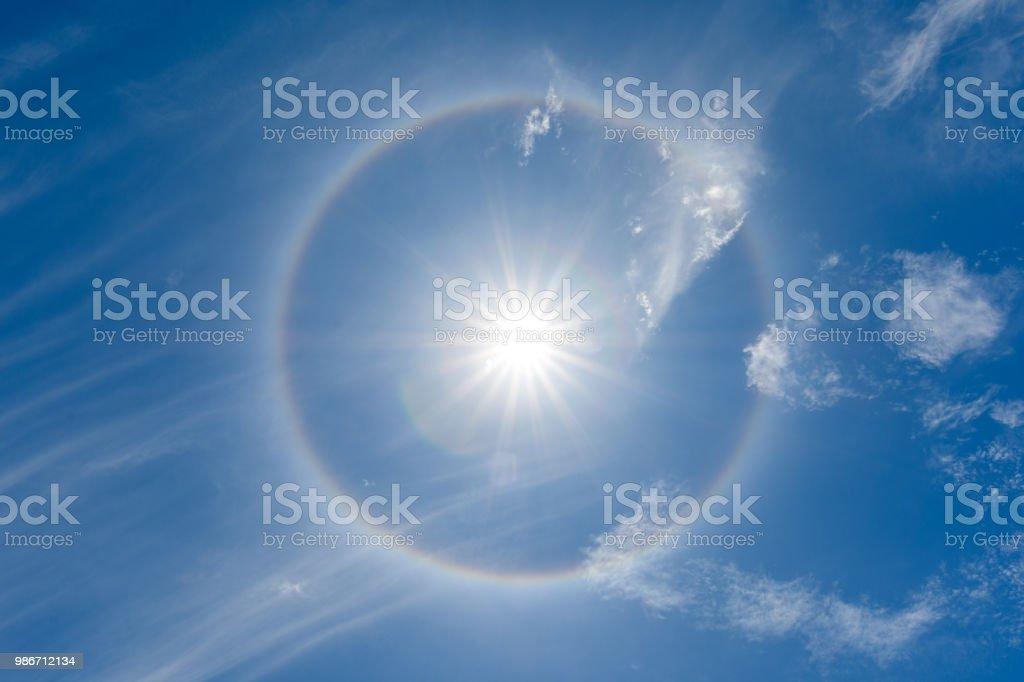 solar halo or antelia, creates around the sun a rainbow crown, meteorological phenomenon stock photo