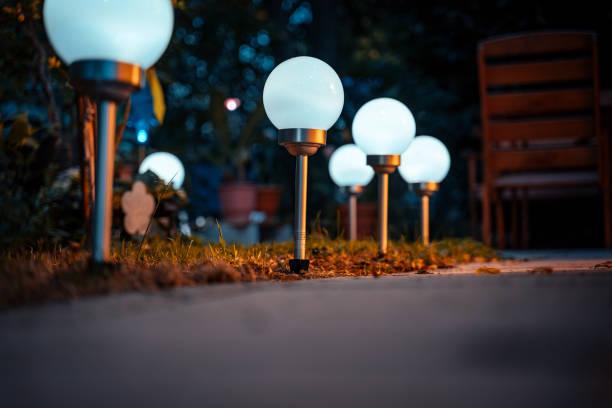 Solar lamps in the garden in autumn stock photo