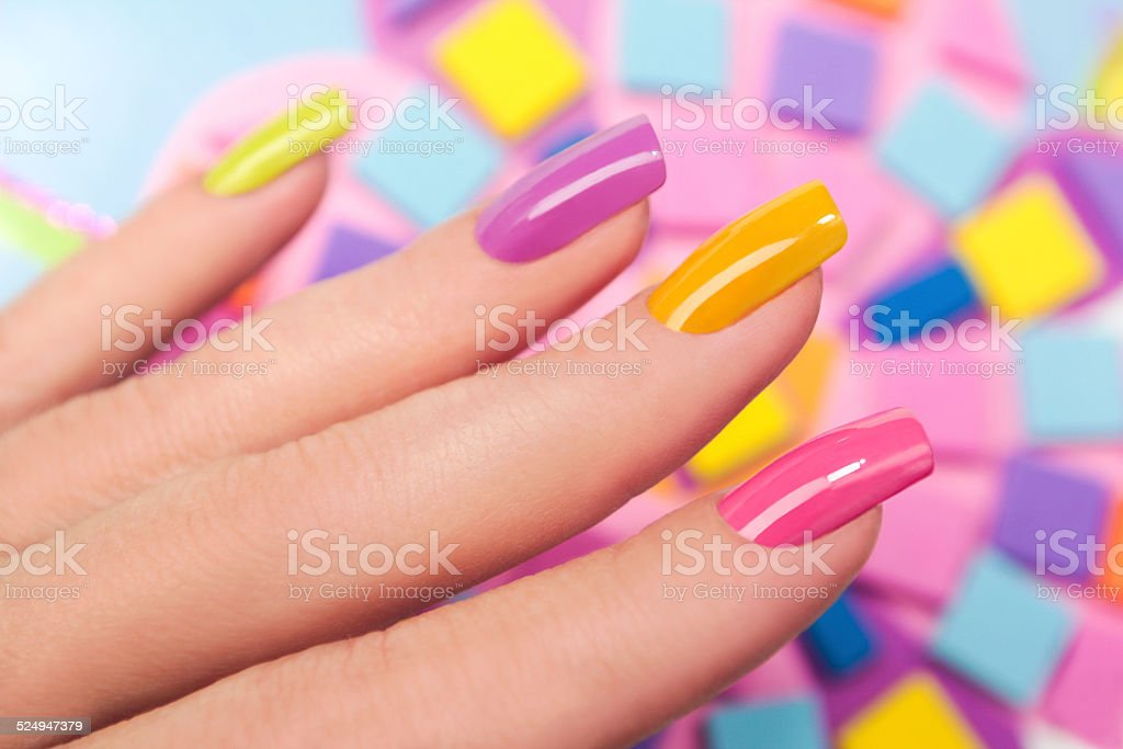 Solar nails are covered with multicolored with colored lacquer on the...