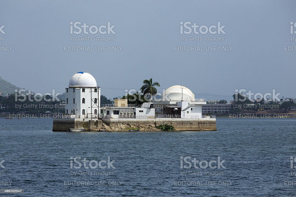 solar observatory situated between a lake stock photo