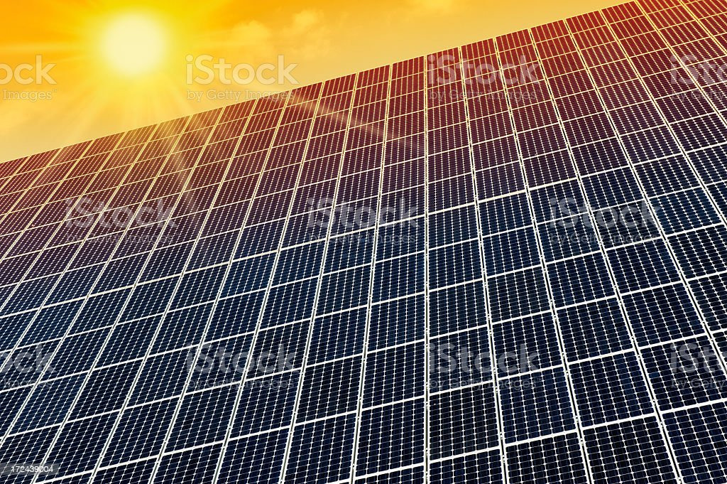 Solar panel against a morning sky with many copyspace royalty-free stock photo