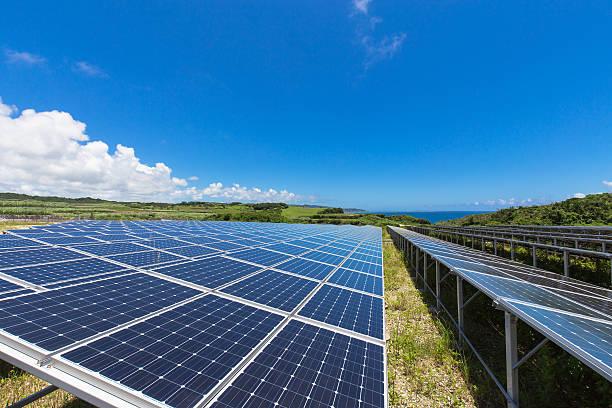 solar panel and the sea of okinawa - solar panel bildbanksfoton och bilder