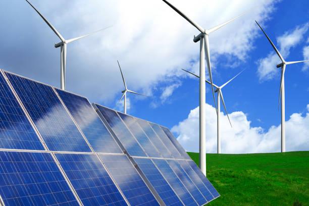 zonnepaneel en windturbine boerderij schone energie. - renewable energy stockfoto's en -beelden