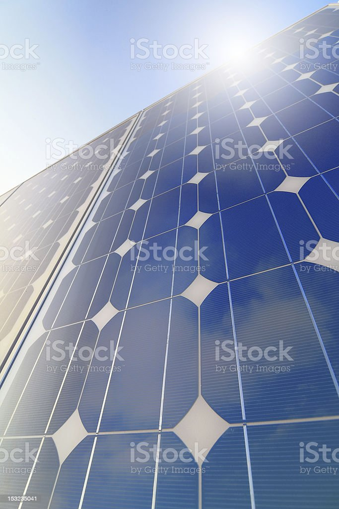 Solar panel closeup with cloud, sky and sun reflection royalty-free stock photo