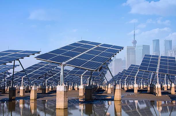 Solar panel farm with Shanghai Bund skyline in background stock photo