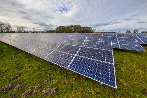 istock Solar panel field in meadow 895857182
