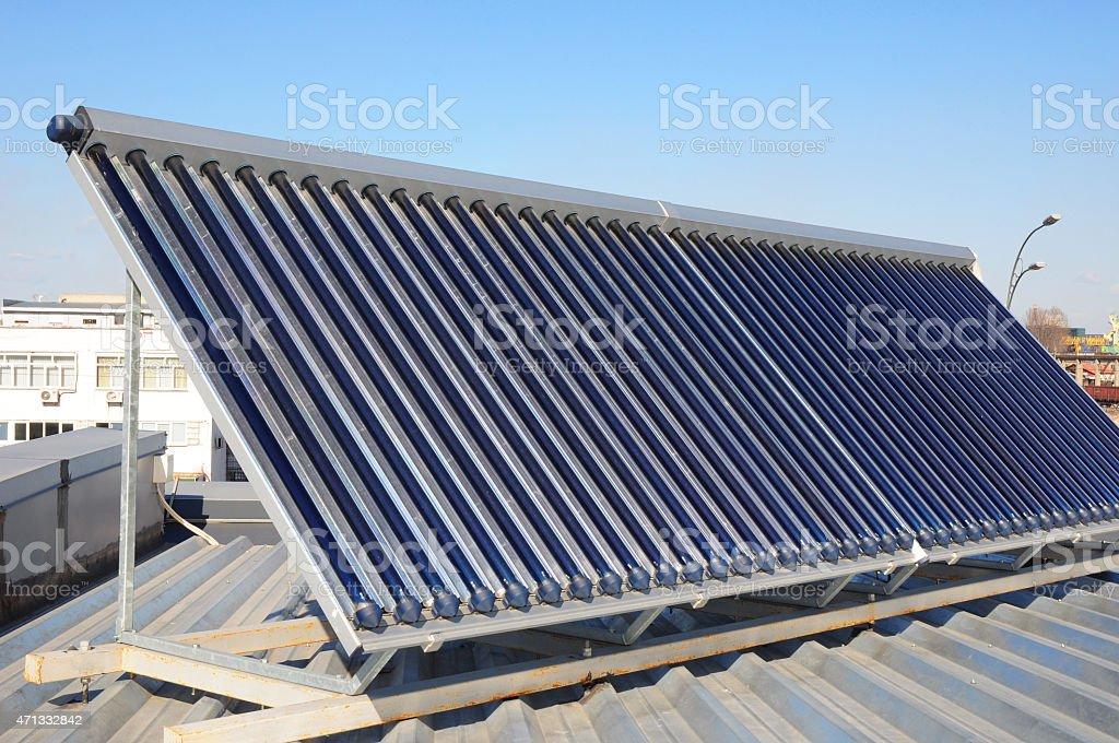 Solar panel heating against blue sky background stock photo