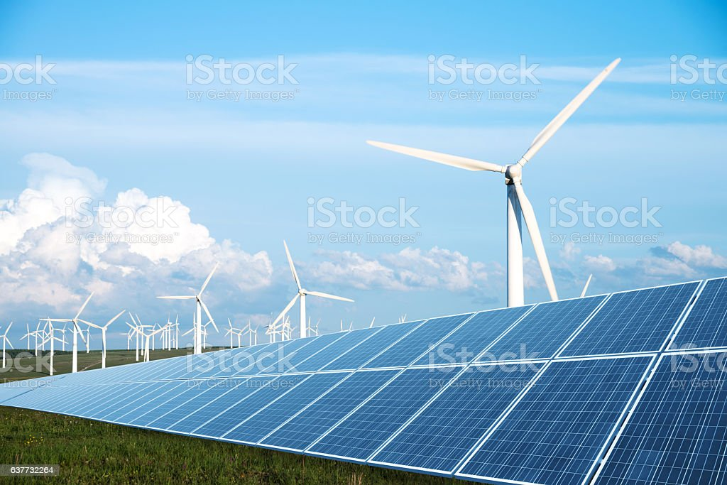 solar panel in green lawn with wind power station solar panel in green lawn with wind power station in blue sky Blue Stock Photo