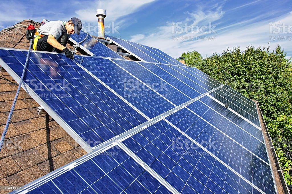 Solar panel installation - Royalty-free Adult Stock Photo