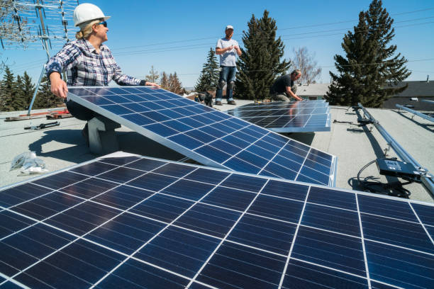 Solar Panel Installation Workers installing solar panels on a residential homes roof. solar panels photos stock pictures, royalty-free photos & images