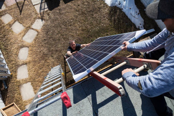 Solar Panel Installation - Transporting Modules to Roof stock photo