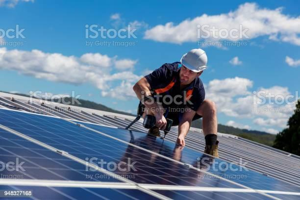 Solar panel installer with drill installing solar panels picture id948327168?b=1&k=6&m=948327168&s=612x612&h=fvwtcdhow7tuljmz9zjwqnrg7nxhzisvyyjrazn0ddw=