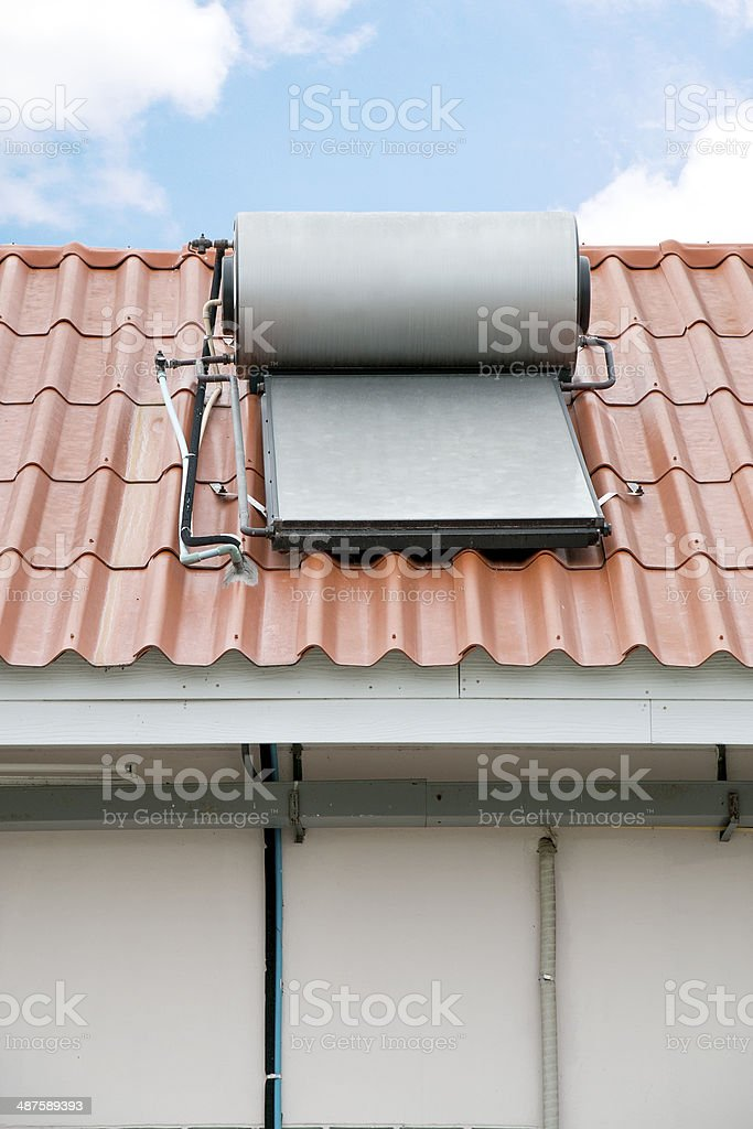Solar panel of hot water installed on rooftop royalty-free stock photo