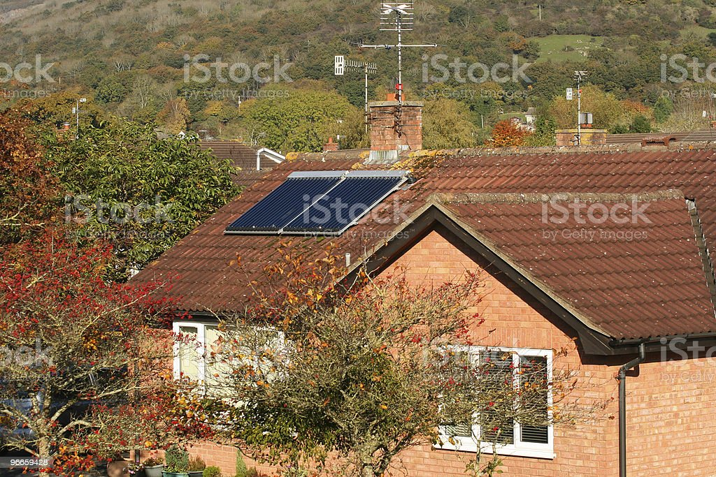 Solar panel on a house roof royalty-free stock photo