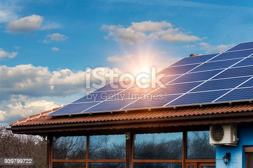 istock Solar panel on a red roof 939799722