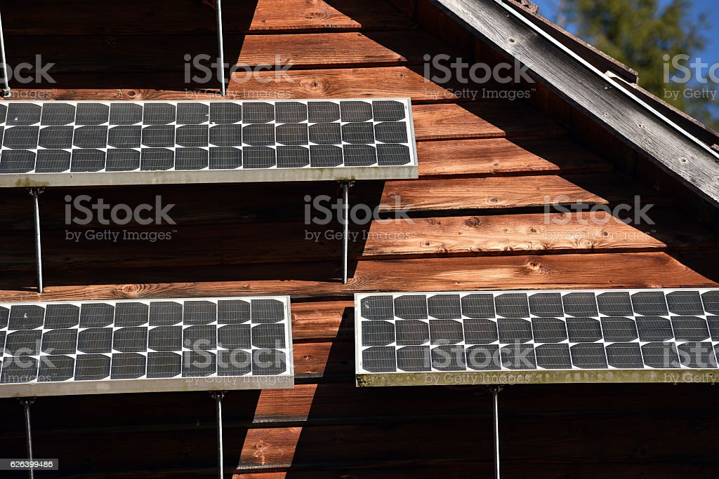 Solar panel on a wooden house stock photo