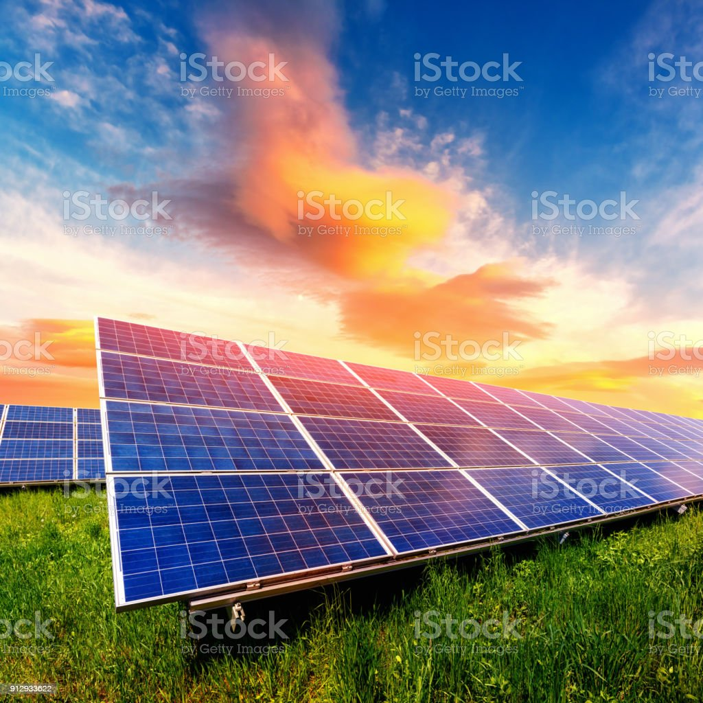 Solar panel on beautiful orange sundown background stock photo