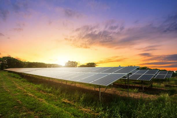 solar panel on dramatic sunset sky background, alternative energy concept - solar panel imagens e fotografias de stock