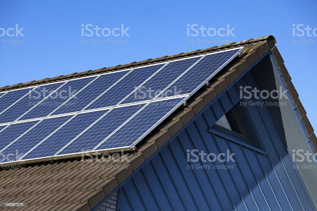 solar panel on gable roof against blue sky royalty-free stock photo